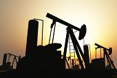 Oil Pumps on Field in the sunset 3D render