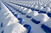 Tribunes of stadium after a strong snowfall. Stadium for game in football(soccer).