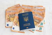 Ukraine Passport For Traveling In Europe Against The Background Of Euro Banknotes. Concept On The Th poster