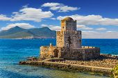 Magnificent three-tiered watchtower built on long cape in the sea. Venetian fort castle Methoni on t poster