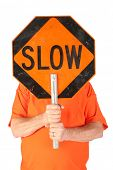 Man with SLOW hand held construction or traffic sign. Isolated on white. Room for text.    poster