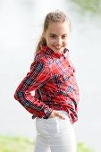A Baby Girl. Adorable Baby With Long Blond Hair Smiling In Casual Plaid Style Outdoor. Happy Little  poster