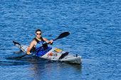 Athletic Man Showing Off In Sea Kayak