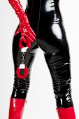 foto of latex woman  - detail of standing woman with handcuffs - JPG