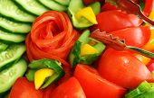 stock photo of risque  - Tomatoes cucumbers and pepper for salad .