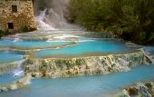 natural spa with waterfalls and hot springs at Saturnia thermal baths, Grosseto, Tuscany, Italy poster