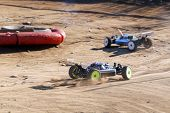 Rc Racing Cars Dueling On Race Track poster