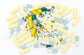 Outline Map Of Greece With Pills In The Background For Health And Cure