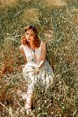 Portrait Of A Young Girl In A White Translucent Dress In Boho Or Hippie Style poster