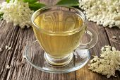 Herbal Tea With Elder Flowers On A Rustic Background poster