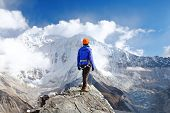 Climber Reaches The Summit Of Mountain Peak. Success, Freedom And Happiness, Achievement In Mountain poster