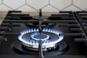 Gas Burner On Black Modern Kitchen Stove. Kitchen Gas Cooker With Burning Fire Propane Gas. poster