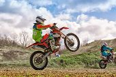 Extreme Motorcycle Race. Biker Rides Off-road On A Motorcycle For Extreme Racing poster