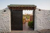 Alhambra Seen Through Doors In Granada