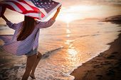 Happy Woman Running On Beach While Celebrateing Independence Day And Enjoying Freedom In Usa poster
