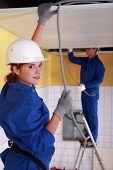 female plumber apprentice and tutor at work