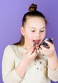 The Best Lip Care Treatment. Cute Little Child Applying Lip Care Stick. Adorable Girl Taking Care Of poster
