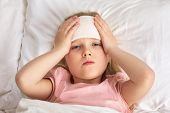 Sick Cold Little Child Girl Lies In Bed With Fever. Top View poster