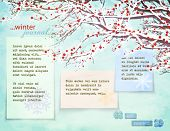 Winter Journal - Snow-capped tree branches with red winter berries against frosty blue background as a backdrop for journal paper notes with plenty of copy space