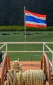 Thai nation flag is on a escort boat
