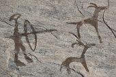 Old ancient petroglyph. Bronze age