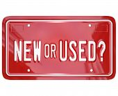 A red license plate with the words New or Used to symbolize the choice between a newly produced or a pre-owned car or other vehicle