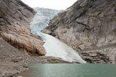 Jostedal glacier falls in to fjord,  Norway, Scandinavia, Europe