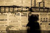 foto of tora  - Hasidic Jews walking in front of propaganda panels Jerusalem Israel - JPG