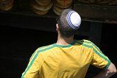 stock photo of tora  - young man wearing jewish kippa jerusalem israel - JPG