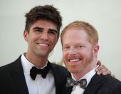 LOS ANGELES - AUG 11:  JESSE TYLER FERGUSON & DATE arriving to Emmy Awards 2011  on August 11, 2012