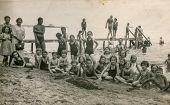 WEJHEROWO, POLAND, CIRCA 1936 - Vintage photo of group of children with their tutors enjoying beach