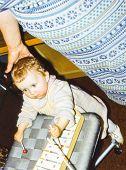 Vintage photo of baby girl playing glockenspiel (1981)