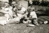 Vintage photo of mother with three little children (early eighties)
