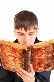 Teenager With Old Book