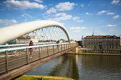 KRAKOW, POLAND - SEP 4: Footbridge Ojca Bernatka - bridge over the Vistula River, Sep 4, 2013 in Krakow, Poland. Bridge is 145 meters /700 tons, cost of its construction is more than 38 mil zÃ??Ã???.