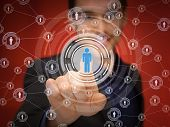business, technology, internet and networking concept - businessman pressing button with contact on