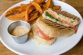 pic of pesto sauce  - Smoked Salmon Panini Spinach Tomato Mozzarella Cheese Pesto Mayo and Sweet Potato Fries - JPG