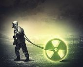 picture of radioactive  - Man in respirator against nuclear background - JPG