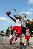 Man Shoots Against Defender In Outdoor Street Basketball Tournament