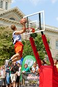 Young Man Jumps Above Rim In Outdoor Slam Dunk Contest
