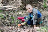 image of face-fungus  - The joyful boy has found an aspen mushroom in wood - JPG