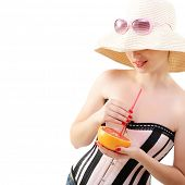 image of panama hat  - Beautiful pinup girl drinking juice of grapefruit in  sunglssses and panama hat - JPG