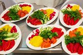 stock photo of picking tray  - Six plates with fresh vegetables on a tray - JPG