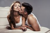 stock photo of hand kiss  - Handsome man and sexy woman in bed - JPG