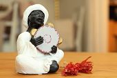 pic of nubian  - A Nubian playing joyfully on a tambourine