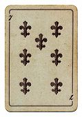 Old Used Grunge Playing Card With Number Seven