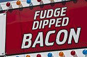 stock photo of bacon  - fudge dipped bacon sign at county fair - JPG