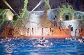 MOSCOW - JAN 8: Actors on stage and synchronized swimmers at Swimming Pool of Sports complex Olympyi