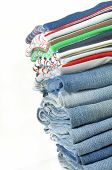 Stack Of Jeans And Colorful T-shirts