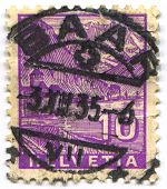 SWITZERLAND - CIRCA 1935: A stamp printed in Switzerland shows image of the The Chateau de Chillon is an island castle located on the shore of Lake Geneva in the commune of Veytaux, circa 1935.